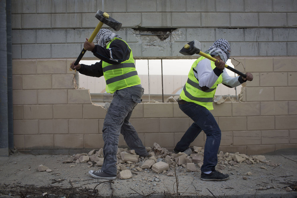 Activists Destroy a Section of the Separation Wall, Bir Nabala,