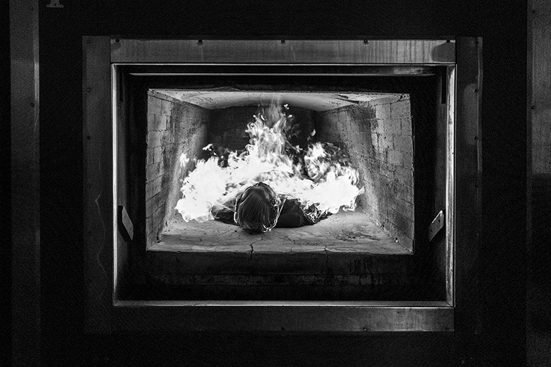 The cremation is a funeral technique used around the world in order to burn the body of a deceased person. Fire reduces to body into ashes wich can have a sacred dimension and can be used for rituals. On the practical aspect it is the t heat (850°c) produced by the flames of the oven wich reduce the body into ashes. Symoblically fire can be seen as a purification and open the path to eternity, but vision and uses of ovens for cremation can be badly considered by many people and religions due to the recall of the ovens used during the Shoah.